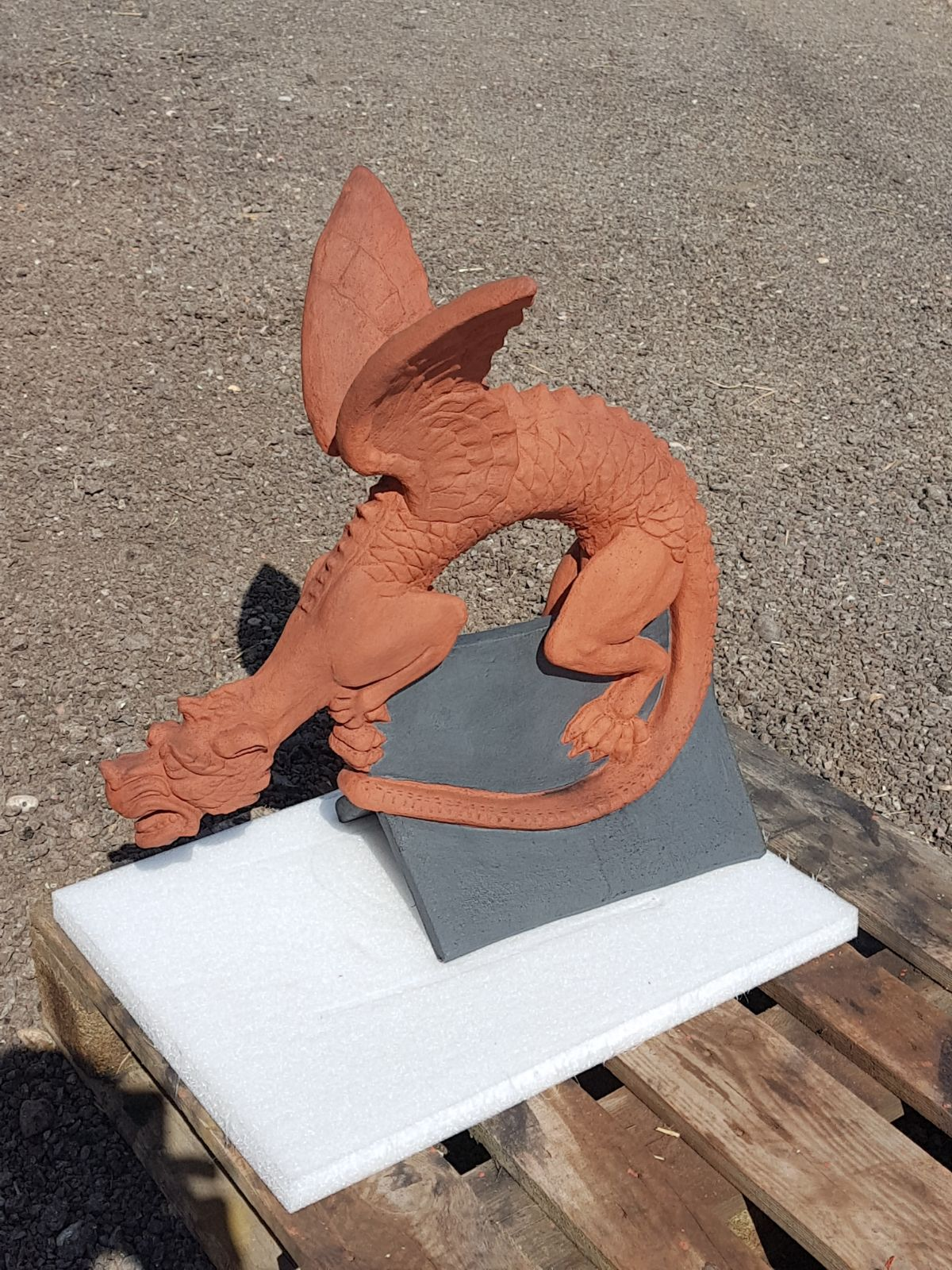grey and terracotta dragon finial