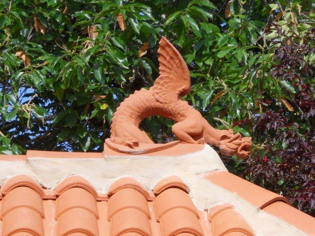 close up of roof dragon on chinese tea house roof
