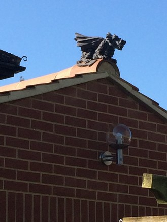 dragon finial on gable end extension roof