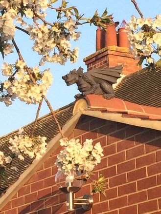 guardian dragon finial installed on roof