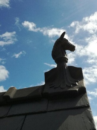 horse finial installed on the roof