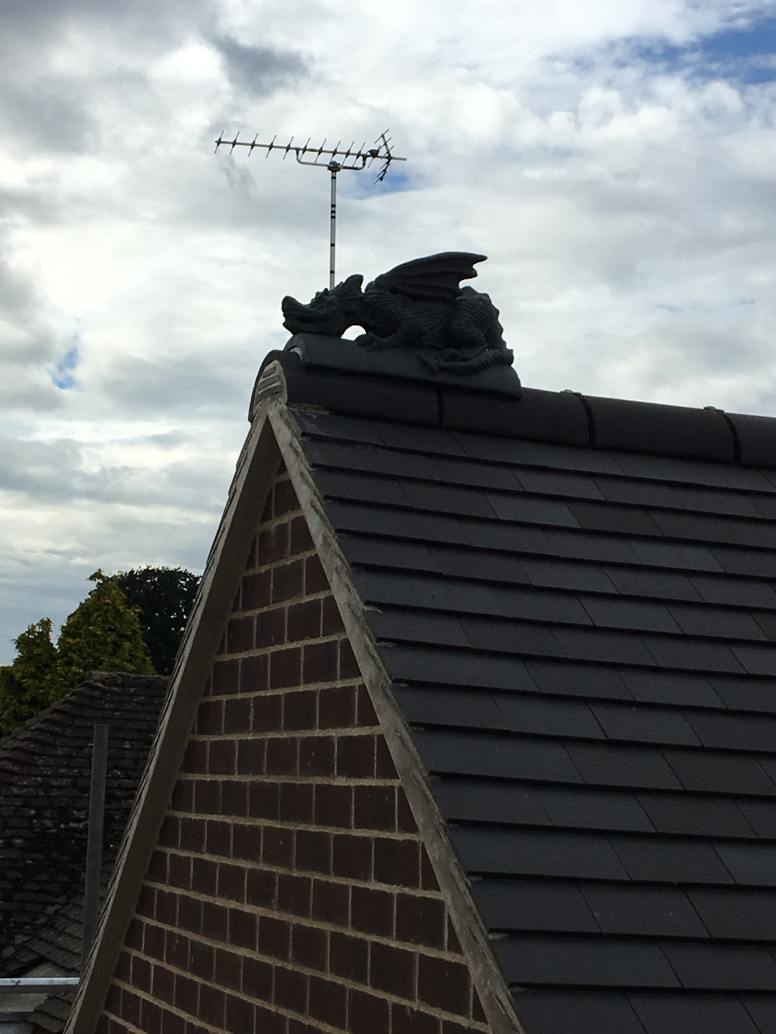 Staffordshire blue segmental ridge dragon install over ridge tiles