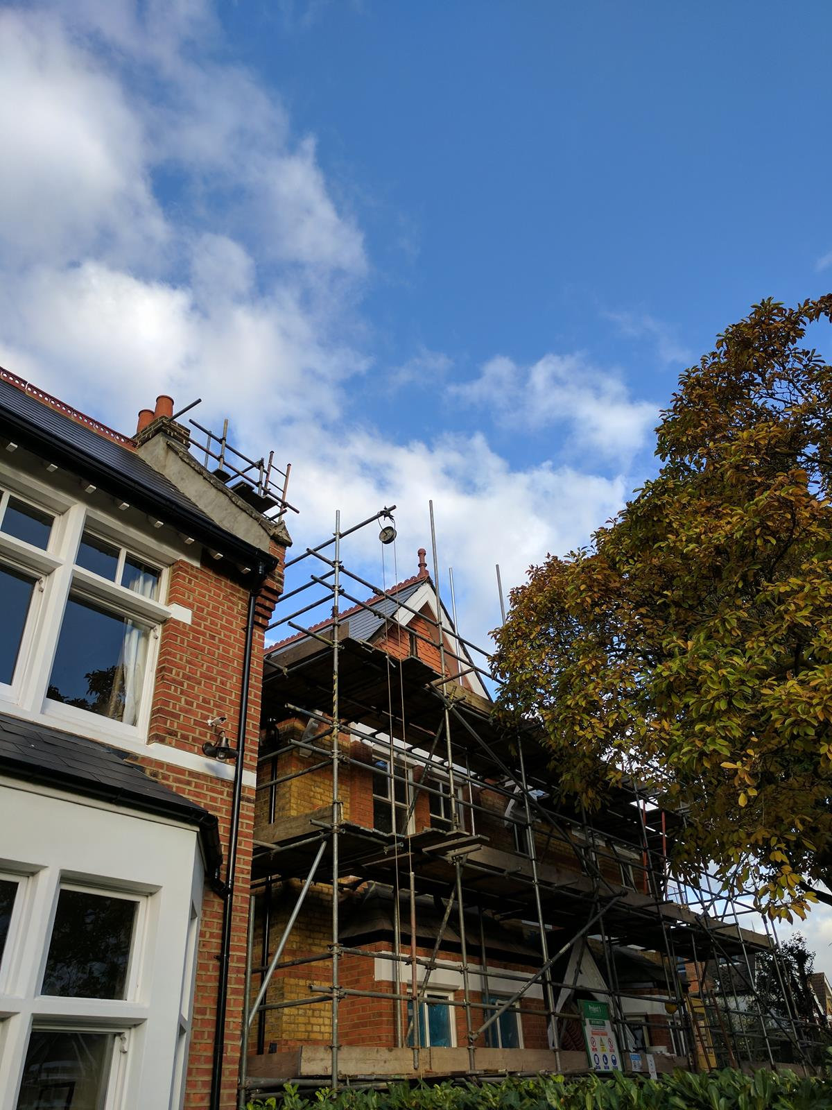 tall ball top roof finial install with scaffolding london