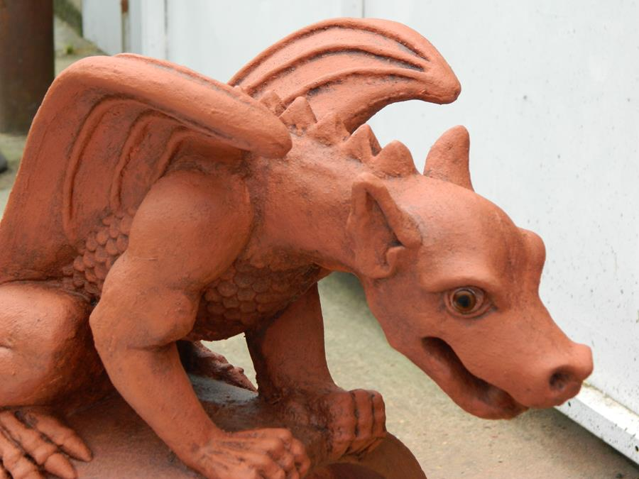 close up mythical dragon finial two tone terracotta